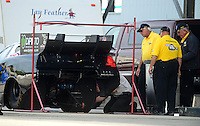 Sept. 30, 2012; Madison, IL, USA: Crew members for NHRA funny car driver Terry Haddock goes through tech inspection during the Midwest Nationals at Gateway Motorsports Park. Mandatory Credit: Mark J. Rebilas-