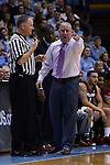 18 January 2015: Virginia Tech head coach Buzz Williams (right) talks to referee Michael Stuart (left). The University of North Carolina Tar Heels played the Virginia Tech University Hokies in an NCAA Division I Men's basketball game at the Dean E. Smith Center in Chapel Hill, North Carolina. UNC won the game 68-53.