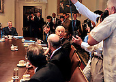 United States Vice President Joe Biden looks back at the photographers after U.S. President Barack Obama (not pictured) kidded him that the Vice President never gets photographed because he sits at the opposite side of the table during a photo-op with bipartisan Congressional Leadership in the Cabinet Room of the White House in Washington, D.C. prior to a meeting to discuss the ongoing efforts to find a balanced approach to deficit reduction.  Visible in the photo from left: U.S. Senator Jon Kyle (Republican of Arizona); Director of the Office of Management and Budget Jacob Lew, and Vice President Biden..Credit: Ron Sachs / Pool via CNP