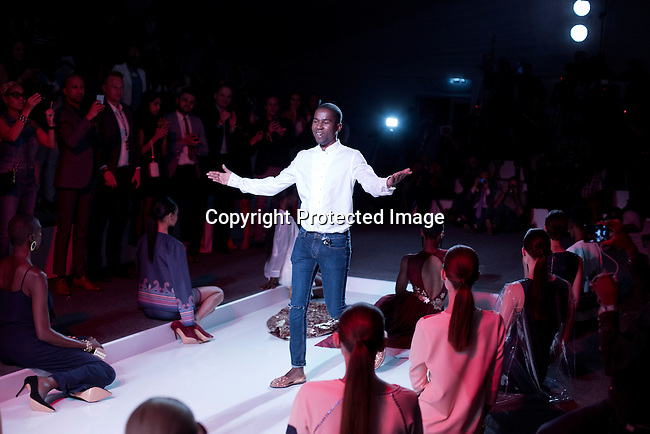 JOHANNESBURG, SOUTH AFRICA OCTOBER 29: Mozambican designer Taibo Bacar on the catwalk during a show at Mercedes Benz Africa fashion week Africa on October 29, 2014 held at Melrose Arch in Johannesburg, South Africa. Designers from all over Africa showed their best collections at the yearly event. (Photo by: Per-Anders Pettersson)