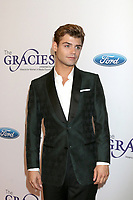 LOS ANGELES - JUN 6:  Garrett Clayton at the 42nd Annual Gracie Awards at the Beverly Wilshire Hotel on June 6, 2017 in Beverly Hills, CA