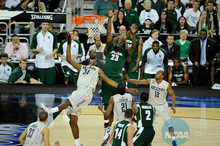 4 APR 2009: Hasheem Thabeet (34) of the University of Connecticut takes on Draymond Green (23) of  Michigan State University during the semifinal game of the 2009 NCAA Final Four Division I Men's Basketball championships held at Ford Field in Detroit, MI.  Michigan State defeated Connecticut 82-73 to advance to the championship game.  Brett Wilhelm/NCAA Photos