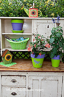 63821-203.09 Potting bench with containers and flowers in spring, Marion Co. IL