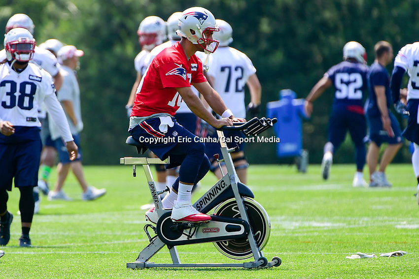 June 13, 2017: New England Patriots quarterback Jimmy Garoppolo (10) rides a stationary bike at the New England Patriots organized team activity held on the practice field at Gillette Stadium, in Foxborough, Massachusetts. Eric Canha/CSM