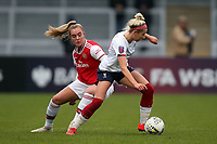 Kirsty Linnett of Liverpool and Jill Roord of Arsenal during Arsenal Women vs Liverpool Women, Barclays FA Women's Super League Football at Meadow Park on 24th November 2019