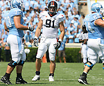 15 September 2007: Virginia's Chris Long (91) between North Carolina's Aaron Stahl (73) and Scott Lenahan (64). The University of Virginia Cavaliers defeated the University of North Carolina Tar Heels 22-20 at Kenan Stadium in Chapel Hill, North Carolina in an Atlantic Coast Conference NCAA College Football Division I game.