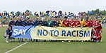 The starters from both teams and the match officials pose behind a banner as part of FIFA's ?Say No to Racism? campaign on Sunday June 26th, 2005, during an international friendly soccer match at Virginia Beach Sportsplex in Virginia Beach, Virginia. The United States won the game 2-0.