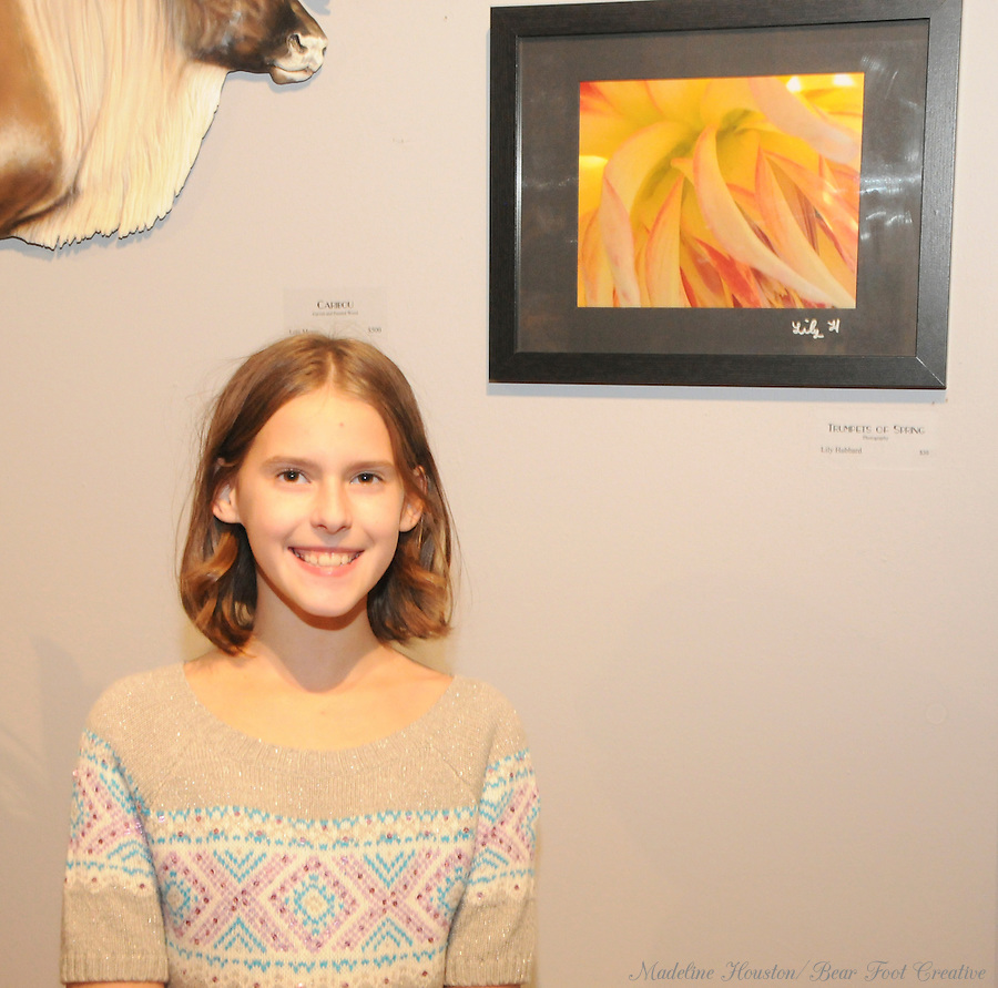 "Artist Lily Hubbard with her photograph ""Trumpets of Spring"" at Rectangle Gallery's Gala Opening for Youth Art Exhibition during Centralia, Washington's Third Thursday on October 20, 2016."