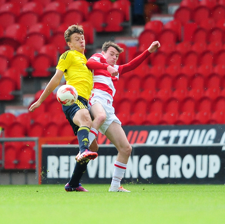 Middlesbrough&rsquo;s Dael Frey vies for possession with Doncaster Rovers&rsquo; Liam Mandeville<br /> <br /> Photographer Chris Vaughan/CameraSport<br /> <br /> Football - Pre-Season Friendly - Doncaster Rovers v Middlesbrough - Saturday 25th July 2015 - Keepmoat Stadium, Doncaster<br /> <br /> &copy; CameraSport - 43 Linden Ave. Countesthorpe. Leicester. England. LE8 5PG - Tel: +44 (0) 116 277 4147 - admin@camerasport.com - www.camerasport.com