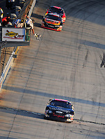 Sept 19, 2008; Dover, DE, USA; NASCAR Camping World Series East driver Aric Almirola takes the checkered flag to win the Sunoco 150 at Dover International Speedway. Mandatory Credit: Mark J. Rebilas-