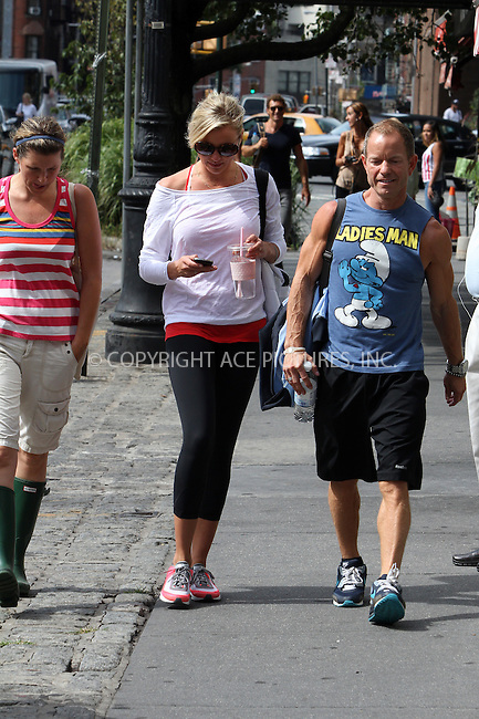 WWW.ACEPIXS.COM . . . . .  ....August 27 2012, New York City....Actress Cameron Diaz walks around her Greenwich Village neighborhood in her training kit and carrying water and a Stella McCartney bag with companions on August 27 2012 in New York City....Please byline: Zelig Shaul - ACE PICTURES.... *** ***..Ace Pictures, Inc:  ..Philip Vaughan (212) 243-8787 or (646) 769 0430..e-mail: info@acepixs.com..web: http://www.acepixs.com