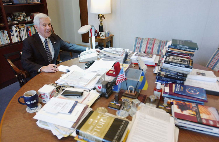 12/3/02.LUGAR--Sen. Richard G. Lugar, R-Ind., who will be chairman of Senate Foreign Relations in the 108th Congress, during an interview in his office. He is working at the table where he and then-Sen. Sam Nunn worked on creating the Nunn-Lugar Cooperative Threat Reduction Program to safeguard and dismantle weapons of mass destruction in the former Soviet Union..CONGRESSIONAL QUARTERLY PHOTO BY SCOTT J. FERRELL