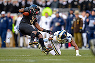 PHILADELPHIA, PA - DEC 8, 2018: Navy Midshipmen defensive back Dakare Coston (9) makes a touchdown saving tackle on Army Black Knights running back Jordan Asberry (3) during game between Army and Navy at Lincoln Financial Field in Philadelphia, PA. Army defeated Navy 17-10 to win the Commander in Chief Cup. (Photo by Phil Peters/Media Images International)
