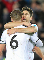 Federico Fernandez of Swansea City hugs Alfie Mawson of Swansea City  at full time during the Premier League match between Swansea City and Liverpool at the Liberty Stadium, Swansea, Wales on 22 January 2018. Photo by Mark Hawkins / PRiME Media Images.