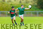 Adam O'Donoghue St Kierans breaks away from Pa Wren Mid Kerry during their SFC clash in Brosna on Saturday