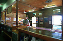 Man at bar of Walkabout Hotel where movie Crocodile Dundee was filmed. Pub moved to avoid highway,  McKinlay. Queensland
