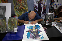 NEW YORK, USA - October 3: An Artist its seen drawing on the artist alley during day one of the New York Comic-Con on October 3, 2019 in New York, USA.<br /> The 2019 New York Comic-Con at the Jacob K. Javits Convention Center Day 1 with the latest in superhero movies, sci-fi shows, animation, video games, comic book releases available to attendees.<br /> (Photo by Luis Boza/VIEWpress/Corbis via Getty Images)