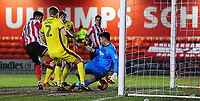 Cheltenham Town's Scott Flinders saves at the feet of Lincoln City's Matt Green<br /> <br /> Photographer Chris Vaughan/CameraSport<br /> <br /> The EFL Sky Bet League Two - Lincoln City v Cheltenham Town - Tuesday 13th February 2018 - Sincil Bank - Lincoln<br /> <br /> World Copyright &copy; 2018 CameraSport. All rights reserved. 43 Linden Ave. Countesthorpe. Leicester. England. LE8 5PG - Tel: +44 (0) 116 277 4147 - admin@camerasport.com - www.camerasport.com