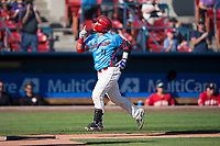 Spokane Indians catcher Isaias Quiroz (11) jogs towards home plate after hitting a home run during a Northwest League game against the Vancouver Canadians at Avista Stadium on September 2, 2018 in Spokane, Washington. The Spokane Indians defeated the Vancouver Canadians by a score of 3-1. (Zachary Lucy/Four Seam Images)
