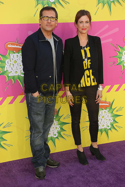 Steve Carell & Kristen Wiig.at The Nickelodeon's Kids' Choice Awards 2013 held at The Galen Center in Los Angeles, California, USA,.March 23rd 2013.full length black blazer yellow writing ankle shoes trousers top grey gray blue jacket jeans denim glasses .CAP/ADM/KB.©Kevan Brooks/AdMedia/Capital Pictures.