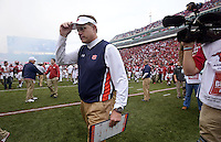 NWA Democrat-Gazette/BEN GOFF @NWABENGOFF<br /> Gus Malzahn, Auburn head coach, leaves the field after falling to Arkansas in overtime on Saturday Oct. 24, 2014 during the game in Razorback Stadium in Fayetteville.