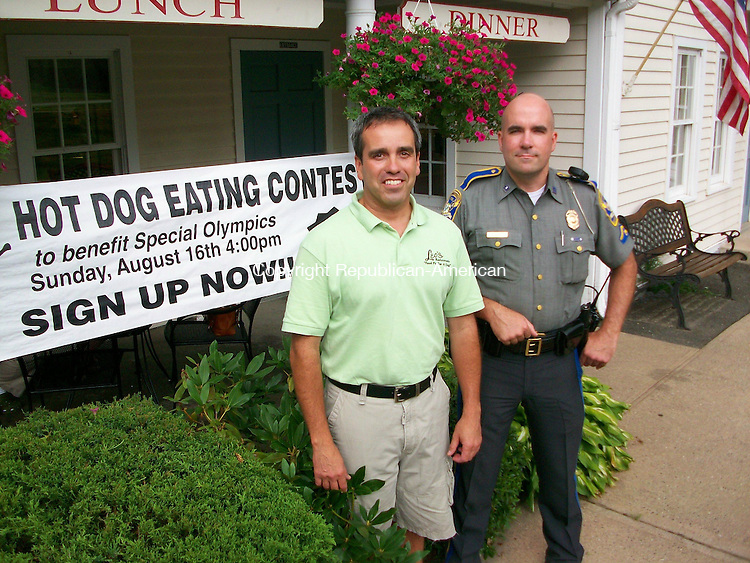 SOUTHBURY, CT - 12 August 2009 - 081209QL01 - Bob Moniz, left, owner of Leo's Restaurant, and State Police Trooper 1st Class John Moreno, of Troop A in Southbury, stand outside Leo's in Southbury on Wednesday, where the restaurant's first Hot Dog Eating Contest will be at 4 p.m. Sunday. Quannah Leonard Republican-American