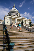 Family climbing the steps of Capitol Building, Washington DC, USA.