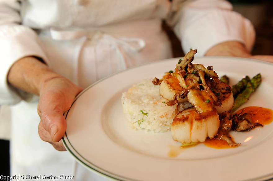 Susan Spicer uses LSU's Jazzmen rice in many of her dishes, including this scallop dish, New Orleans, Thurs., Dec. 10, 2009..(AP Photo/Cheryl Gerber)