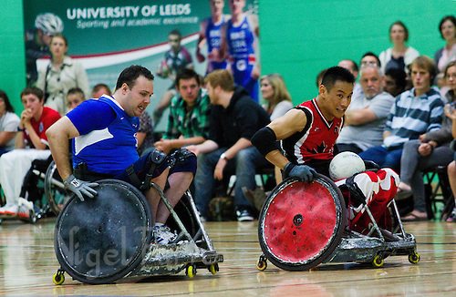 15 AUG 2011 - LEEDS, GBR - Canada's Ian Chan (right) races for the goal line ahead of Great Britain's Ross Morrison during the wheelchair rugby exhibition match between the two teams .(PHOTO (C) NIGEL FARROW)