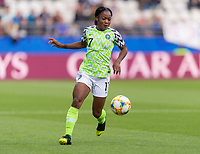 REIMS, FRANCE - JUNE 8: Francisca Ordega #17 of Nigeria dribbles the ball during a 2019 FIFA Women's World Cup match between Norway and Nigeria at Stade Auguste-Delaune on June 8, 2019 in Reims, France.