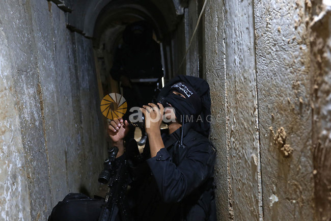 A Palestinian militant breaks his fast as he guards the tunnel in the east of Gaza city on the Muslim holy fasting month of Ramadan on May 24, 2018. Ramadan is sacred to Muslims because it is during that month that tradition says the Koran was revealed to the Prophet Mohammed. The fast is one of the five main religious obligations under Islam. More than 1.5 billion Muslims around the world will mark the month, during which believers abstain from eating, drinking, smoking and having sex from dawn until sunset. Photo by Ashraf Amra