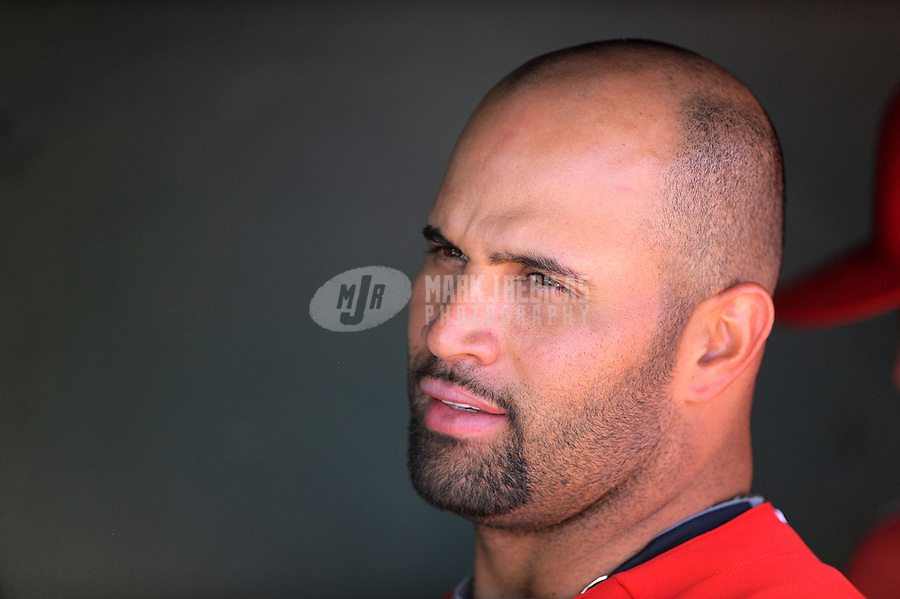 Mar. 6, 2012; Tempe, AZ, USA; Los Angeles Angels designated hitter Albert Pujols in the dugout in the fourth inning against the Chicago White Sox during a spring training game at Tempe Diablo Stadium.  Mandatory Credit: Mark J. Rebilas-
