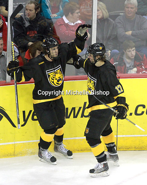 Colorado College's Alexander Krushelnyski (16) celebrates his goal with with Charlie Taft (17). Nebraska-Omaha defeated Colorado College 7-5 Friday night at CenturyLink Center in Omaha. (Photo by Michelle Bishop) .