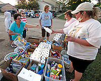 Donated cleaning supplies are handed out in the Nashville suburb of Bellevue on Saturday, May 8, 2010.