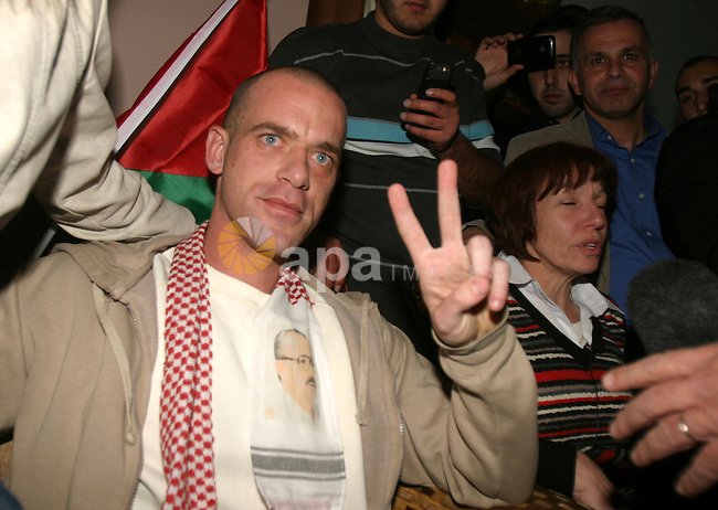 French-Palestinian Salah Hamuri is welcomed in Dahyat Al Barid, near Ramallah, after being released on December 18, 2011. Hamuri was convicted of plotting to assassinate a Jewish religious leader and had been due to complete his seven-year sentence in March. Israel released 550 Palestinian prisoners to complete a swap deal which brought about the release of captive soldier Gilad Shalit. Photo by Mahfouz Abu Turk