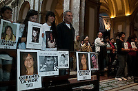 On the first month anniversary oif the train accident that left 51 dead and over 700 injured protest demanding justice, Cardenal Jose Bergoglio, archbishop of Buenos Aires, offers a mass for relatives and friends of the victims.