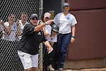 30 MAY 2016: Messiah College Head Coach, Amy Weaver, signals to her player during the Division III Women's Softball Championship is held at the James I Moyer Sports Complex in Salem, VA.  University of Texas-Tyler defeated Messiah College 7-0 for the national title. Don Petersen/NCAA Photos