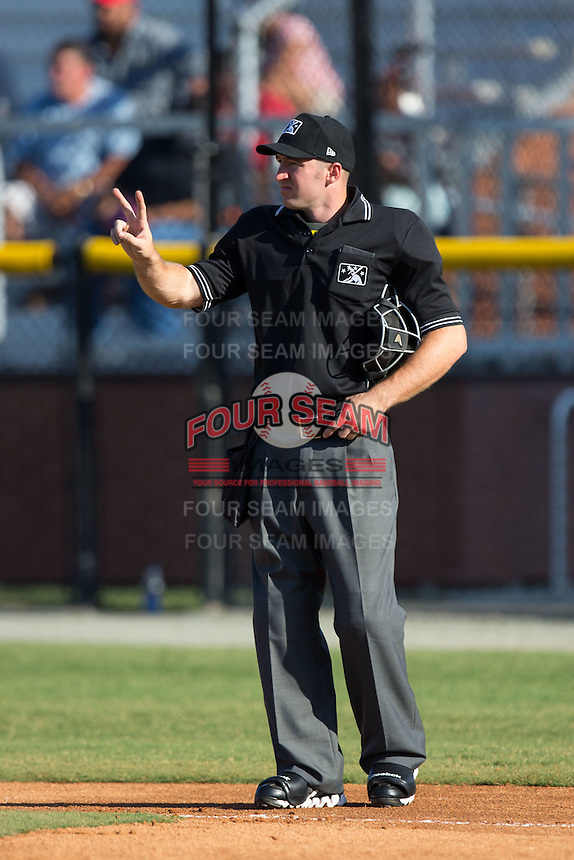 Home plate umpire Mark Stewart lets the pitcher know he has two warm-up tosses left during the Appalachian League game between the Bluefield Blue Jays and the Burlington Royals at Burlington Athletic Stadium on June 26, 2016 in Burlington, North Carolina.  The Blue Jays defeated the Royals 4-3.  (Brian Westerholt/Four Seam Images)