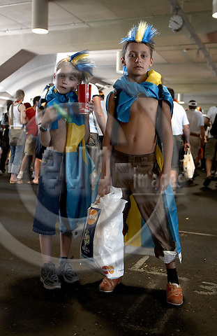 """MUNICH - GERMANY 24. JUNE 2006 --  FIFA World Cup 2006 Germany - Game of sixteen - Munich Arena - Germany defeats Sweden 2-0 - Swedish fans  -- PHOTO: CHRISTIAN T. JOERGENSEN / EUP & IMAGES..This image is delivered according to terms set out in """"Terms - Prices & Terms"""". (Please see www.fotofactory.dk for more details)"""