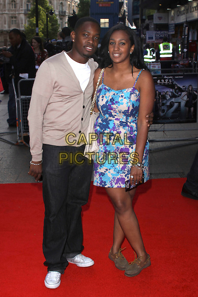 AML AMEEN & GUEST .World Film Premiere of '4,3,2,1' at the Empire, Leicester Square, London, England, UK, May 25th 2010 4321 4-3-2-1 arrivals full length jeans cardigan beige trainers blue print dress white t-shirt .CAP/AH.©Adam Houghton/Capital Pictures.