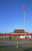 The Tian'anmen Tiananmen Square with the entrance to the Forbidden City, the Gate of Heavenly Peace, military guards, a Chinese flag and a Mao painting Beijing, China, Asia