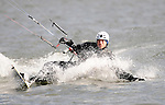 Jeff Yates of Coeur D'Alene skims across Lake Coeur D'Alene yesterday afternoon while kite surfing. Mandatory Credit: James Snook