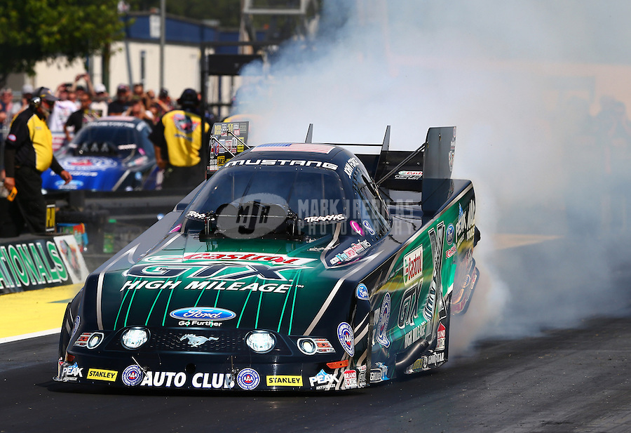 Aug. 1, 2014; Kent, WA, USA; NHRA funny car driver John Force during qualifying for the Northwest Nationals at Pacific Raceways. Mandatory Credit: Mark J. Rebilas-USA TODAY Sports