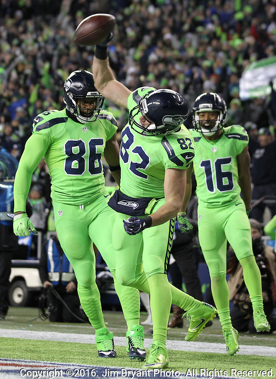 Seattle Seahawks tight end Luke Willson (82) prepares to spike the ball after scoring on a 8-yard touchdown pass from quarter Russell Wilson at CenturyLink Field in Seattle, Washington on December 15, 2016.  The Seahawks beat the Rams 24-3.  ©2016. Jim Bryant Photo. All Rights Reserved