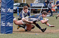 A St Mary's player crashes over for a try during the BUCS Premier South game between St Mary's and Oxford at St Mary's University, Twickenham on Wed Feb 4, 2015