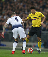 Jadon Sancho of Borussia Dortmund takes on Tottenham Hotspur's Toby Alderweireld<br /> <br /> Photographer Rob Newell/CameraSport<br /> <br /> UEFA Champions League Round of 16 First Leg - Tottenham Hotspur v Borussia Dortmund - Wednesday 13th February 2019 - Wembley Stadium - London<br />  <br /> World Copyright © 2018 CameraSport. All rights reserved. 43 Linden Ave. Countesthorpe. Leicester. England. LE8 5PG - Tel: +44 (0) 116 277 4147 - admin@camerasport.com - www.camerasport.com