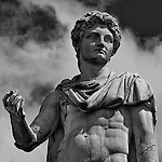 bust of the Castor statue at the top of Michelangelo's Scala Cordonata leading to the Campidoglio in Rome