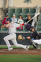 Ben Moore (25) of the Greenville Drive follows through on his swing against the Kannapolis Intimidators at CMC-Northeast Stadium on April 28, 2015 in Kannapolis, North Carolina.  The Intimidators defeated the drive 3-2.  (Brian Westerholt/Four Seam Images)