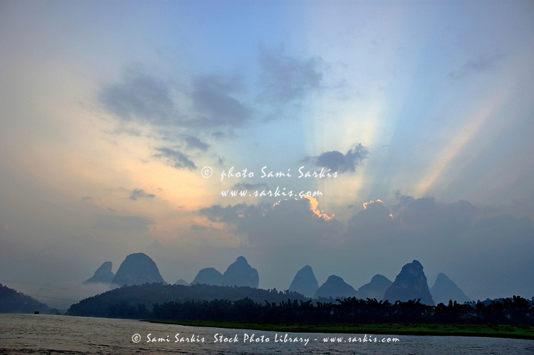 Limestone peaks and Li Jiang River at sunrise, Yangshuo, Guangxi, China.