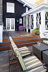 An expansive deck provides ample space for relaxing or entertaining at this Pacific Northwest home. This image is available through an alternate architectural stock image agency, Collinstock located here: http://www.collinstock.com